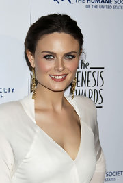Emily paired her sleek bun and plunging neckline with gold dangle earrings.