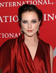 Newly engaged actress, Evan Rachel Wood steps out at the 26th Annual Night Of Stars Awards looking stunning in her red satin dress and voluminous pinned back updo.