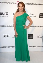 Jane Seymour showed off her elegant style and killer figure in an emerald green one shoulder gown while at Elton John's Oscars Party.