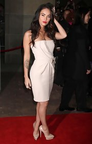"Megan Fox donned a pristine white strapless gown with delicate draping to the premiere of ""Passion Play."""