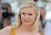 Kirsten Dunst showcased her alluring beauty with a swipe of cherry red lipstick while promoting 'Melancholia.'