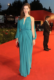 Rebecca is breathtaking in this jewel-toned evening dress. The lovely gathering and sleeve slits are exquisite!