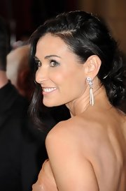 Demi Moore showed off her dangling diamond earring at the Academy Awards with a romantic side-swept 'do.