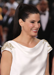 Sandra Bullock wore her hair styled in a chic wrapped ponytail at the 84th Annual Academy Awards.