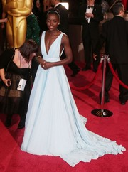 Stunning once again on the red carpet, Lupita Nyong'o selected a ladylike baby blue A-line gown for the 2014 Academy Awards.