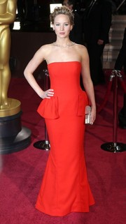 Jennifer Lawrence went for a classic peplum silhouette in a red hot color for the 2014 Academy Awards.