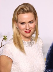 Naomi Watts topped off her Oscars look with a swipe of rich red lipstick.