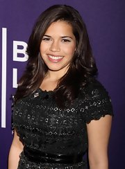 """Ugly Betty' star America Ferrera showed off her brunette tresses while attending the Tribeca Film Festival. She swept her bangs to the side with a light curl."