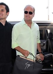 Kelsey Grammer looked easy-breezy in his mint-green button-down during a flight out of LA.