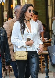 Shay Mitchell looked oh-so-hip with her Sunday Somewhere round shades while strolling in New York City.