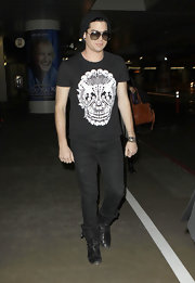Adam Lambert keeps a low profile while traveling through the Los Angeles airport.  Here pictured in a simple black wool cap.