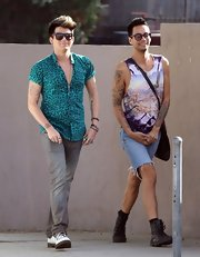 Adam Lambert opted for a pair of faded gray jeans for his casual daytime look while grabbing a bit to eat with friends.