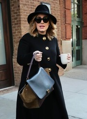 Adele topped off her ensemble with a black fedora.