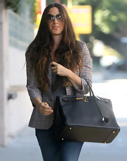 Alanis Morissette switched up her usual boho style, carrying a super luxe black Birkin bag.