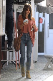 Alessandra Ambrosio paired her top with classic blue jeans.