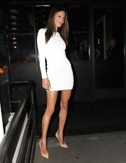 Alessandra Ambrosio struck a pose in this long-sleeve white bandage dress.