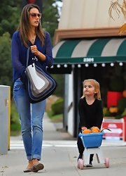 Alessandra Ambrosio paired her low-key pumpkin patch gear with a blue graphic striped Salvatore Ferragamo Resort 2012 Satchel.