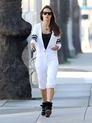 Alessandra Ambrosio slipped on a pair of black leather high tops with velcro straps for a coffee run in Santa Monica, California.