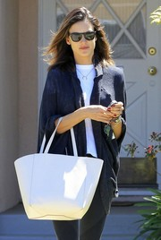 Alessandra Ambrosio ran errands on a sunny day wearing a pair of wayfarer sunglasses.