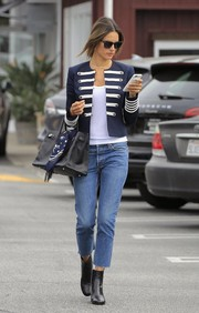 Alessandra Ambrosio balanced out her dressy top with casual cropped jeans.