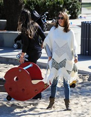 Alessandra Ambrosio enjoyed a cool day out wearing an oversized knit poncho by Elizabeth and James.