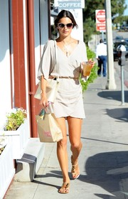 Alessandra Ambrosio battled the heat in chic style in a light gray wrap mini dress while out in Brentwood.
