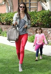 Alessandra kept her look casual but still hip with a light gray structured leather jacket.