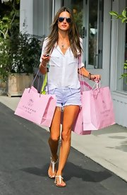 Alessandra kept her look summery and light with a pair of striped cutoffs.