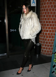 Alessandra bundled up in her thick fur coat while out for the night with her hubby.