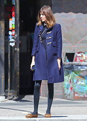 Alexa Chung headed out in NYC wearing a pair of brown leather moccasins with beaded embellishments.