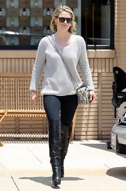 Ali Larter kept her look classic and sophisticated with a tan V-neck sweater.