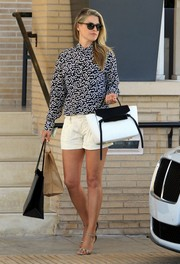 Ali Larter kept it chic and cool in a heart-print blouse and white shorts while shopping at Barneys New York.