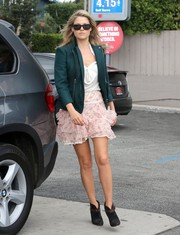 Ali Larter was out and about in LA wearing black ankle boots with a frilly pink mini skirt.