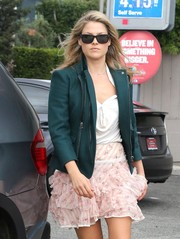 Ali Larter tamed her frilly skirt and top combo with a green zip-up jacket while running errands in LA.