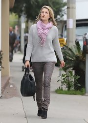 A solid pink scarf adds some girlie color to Ali Larter's look while out in LA.