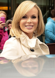 Amanda Holden smiled at fans in Manchester in a sleek shoulder-length bob.