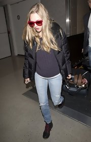 Amanda Seyfried bundled up in this navy down jacket while traveling  through Newark Airport.