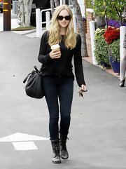 Amanda Seyfriend wore a pair of distressed leather lace-up boots while shopping at Fred Segal in West Hollywood.