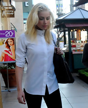 Amber Heard looked sharp in this crisp white button down while out shopping at The Grove with a friend.