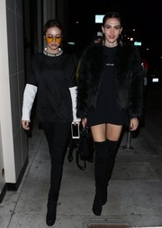 Amelia Hamlin was edgy-sexy in black thigh-high boots while enjoying a night out at Catch.