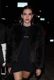 Amelia Hamlin layered a black fur jacket over a slogan tee for a night out at Catch.