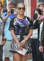 Jennifer Lopez completed her busy-looking outfit with a sequined lace-up mini skirt, also by Roberto Cavalli.