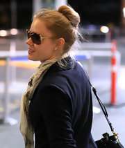 Amy Adams was spotted at the Vancouver airport sporting a classic bun. So chic, so effortless and so easy to recreate. Simply pull tresses up into a high ponytail, wrap it around the hair elastic and secure the ends with a bobby pin.