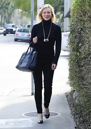 Amy Smart chose black skinny pants for a casual look for dinner in Hollywood.