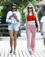 Alina Baikova flaunted her fabulous legs in distressed jean shorts.