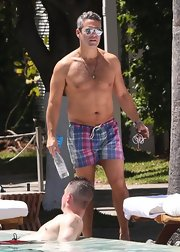 Andy Cohen looked stylish poolside when when sported these plaid swim trunks.