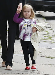 Vivienne Jolie Pitt's ruby red ballet flat's look like they are straight out of Oz.