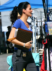 While on the set of 'Rizzoli and Isles,' Angie Harmon wore her shiny tresses in a casual ponytail.