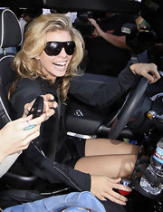 "Annalynne looks red carpet ready for the gym with her hair styled very curly with stylish black framed ""8036B"" sunglasses. They are oversized and a look she pulls off well."