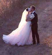 Anne Hathaway tied the knot in this frothy appliqued off-the-shoulder custom gown.